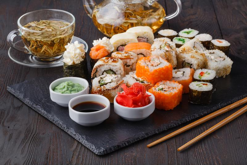 Various Roll with salmon, avocado, cucumber. Sushi menu. Japanese food stock image