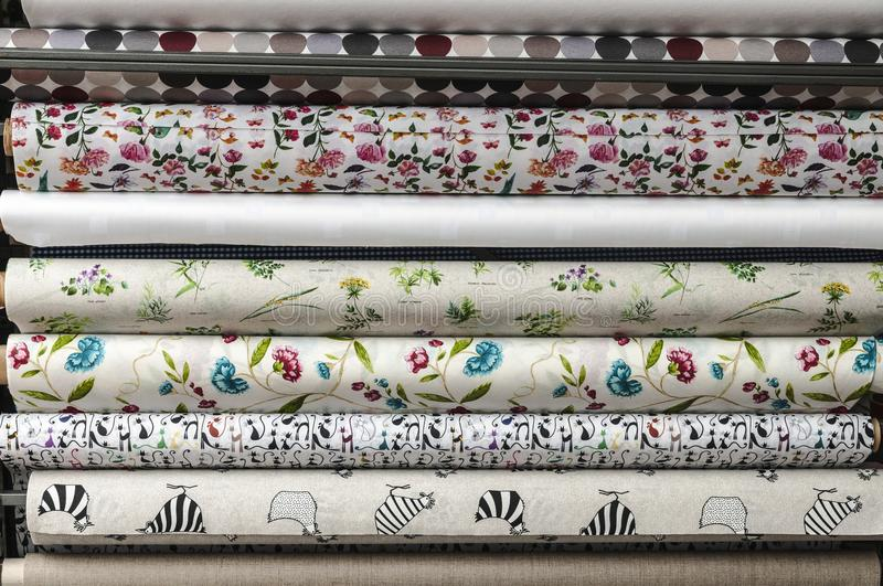 Various rolls of wallpaper displayed stock images