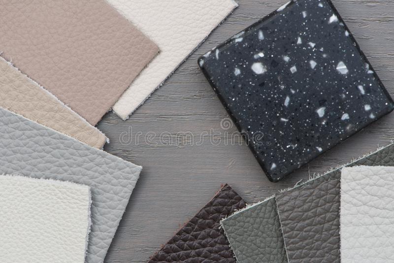 Various Samples of different colour Leather, Acrylic work surface on grey Floor stock photo