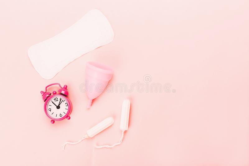 Various sanitary products on pastel pink background royalty free stock photos