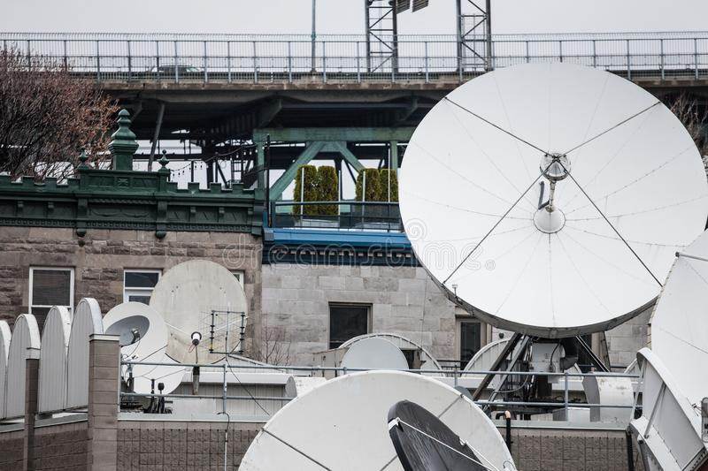Various satellite dishes and emitters in the technical hub of a media television and radio broadcaster in the suburbs of Montreal,. Picture of a bunch of royalty free stock photography