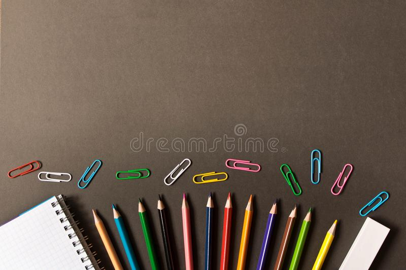 Various school supplies on the blackboard background . The concept of education. With empty space for text stock image