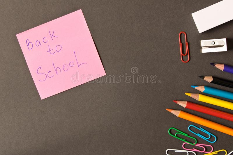 Various school supplies on the blackboard background . The concept of education. With empty space for text stock photo
