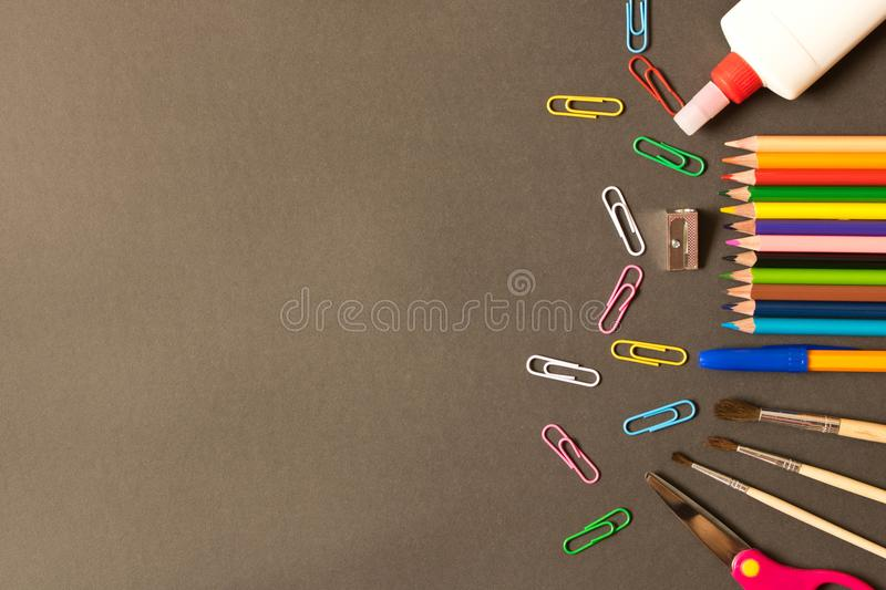 Various school supplies on the blackboard background . The concept of education. With empty space for text royalty free stock images