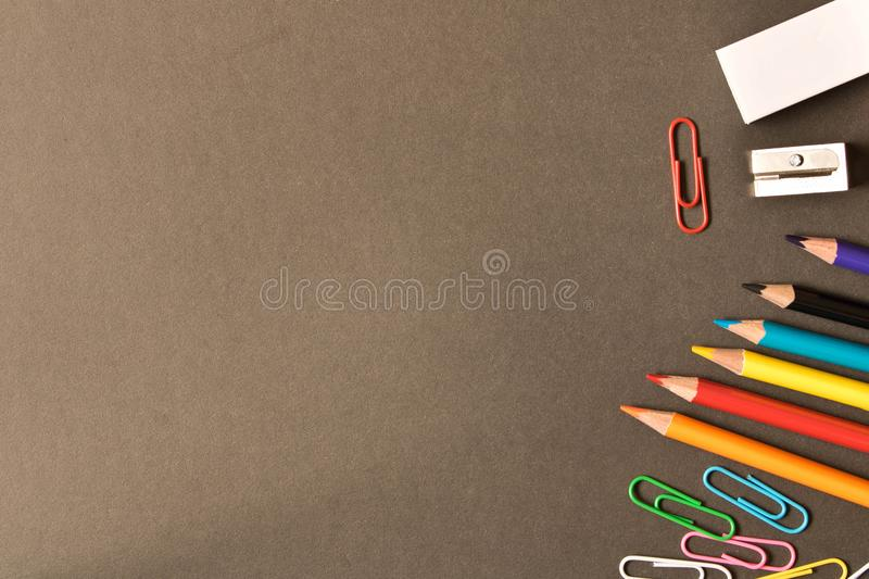 Various school supplies on the blackboard background . The concept of education. With empty space for text royalty free stock photos