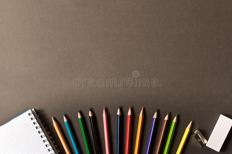 Various school supplies on the blackboard background . The concept of education. With empty space for text royalty free stock photography