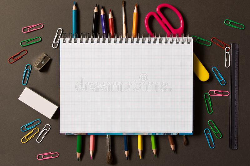 Various school supplies on the blackboard background . The concept of education. With empty space for text stock photos