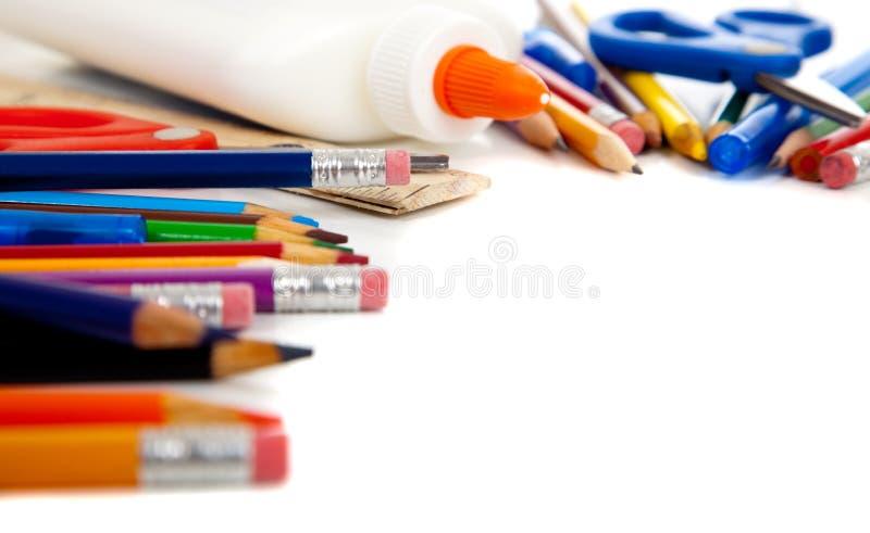Various school supplies on a white background. Various school supplies including pencils, pens, glue, scissors stock photos