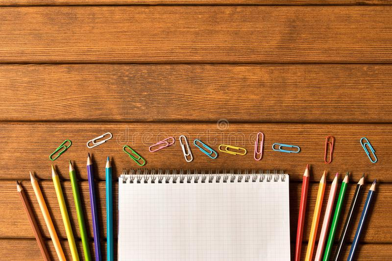 Various school supplies on wooden background. Concept of education. A blank text space royalty free stock photography