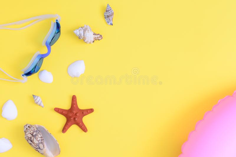 Various seashells and a red starfish on a yellow background. Bright summer pattern. Beautiful picture. royalty free stock photography