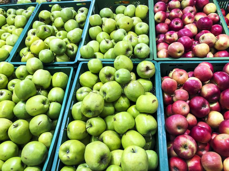 Various seasonal fruits on supermarket shelves royalty free stock photography