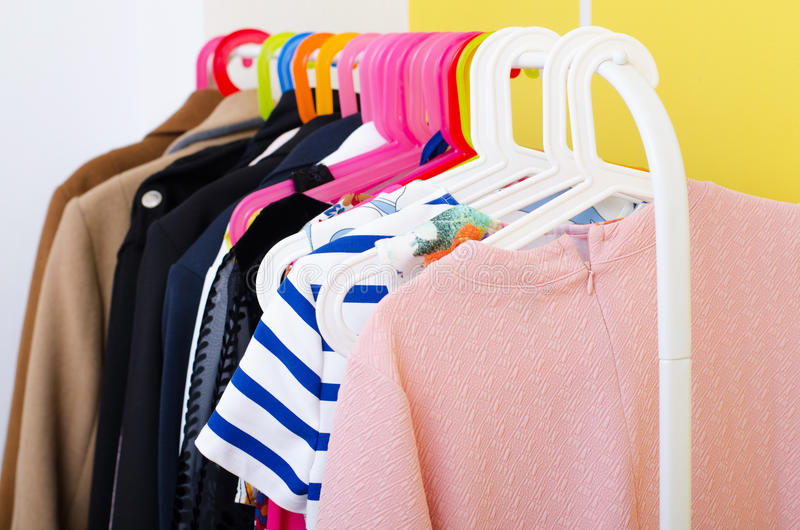 Various second hand woman clothes on the hanger hanging in boutique.  royalty free stock photo