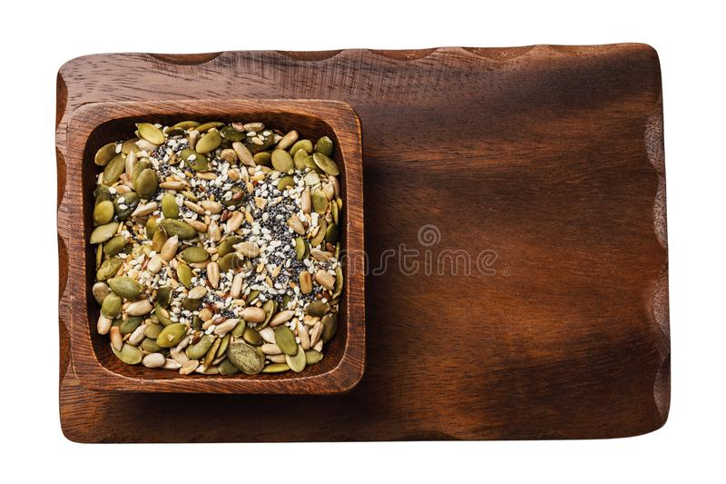 Various seeds in a cup on a wooden stand isolated royalty free stock image