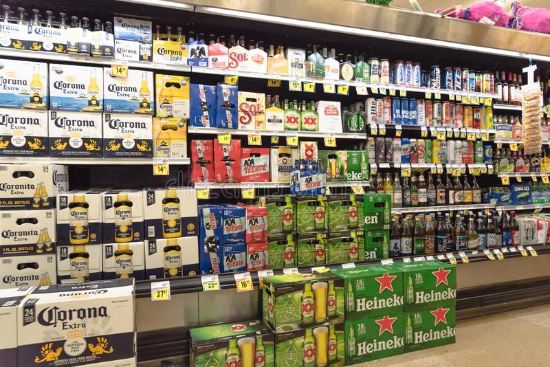 Various selection of Mexican imported beer bottles at supermarket royalty free stock images