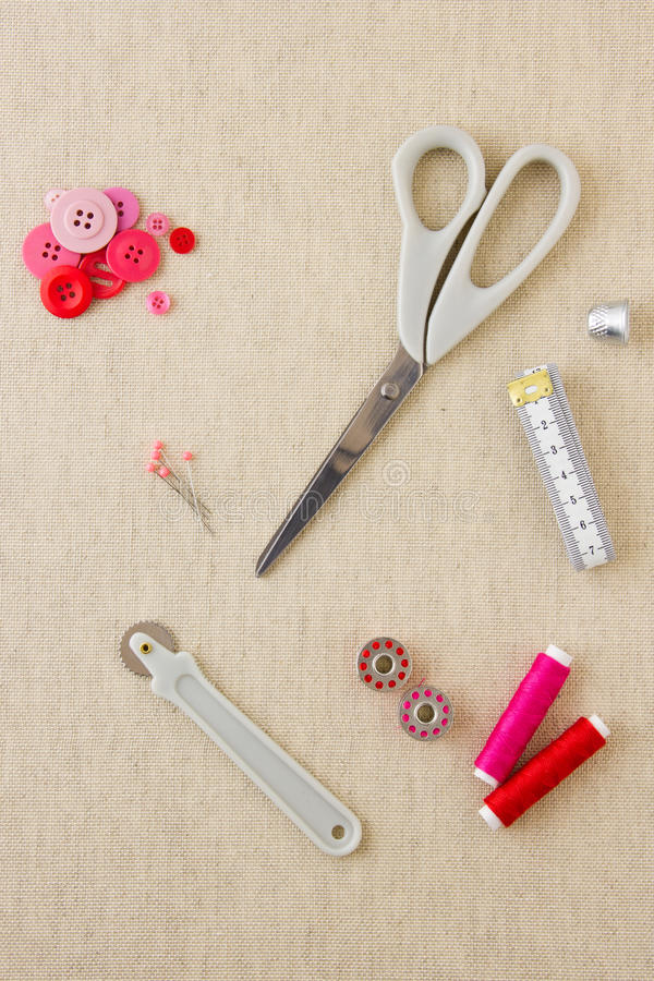 Sewing accessories in red and pink tones royalty free stock photo