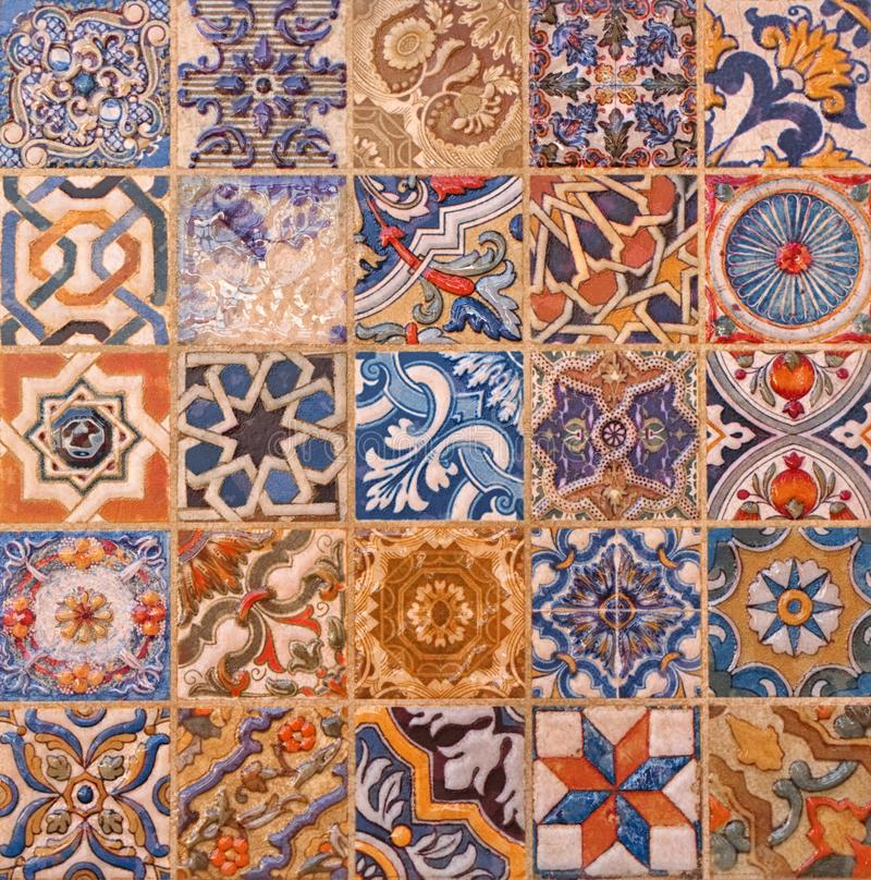 Beautiful coloured ceramic floor tile. Various small patterned tiles, including floral and geometric designs, placed together to form one larger floor tile stock photo