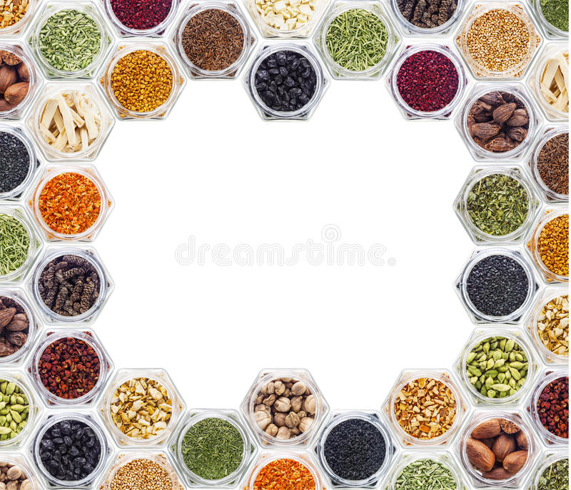 Various spices and herbs on white background. Border frame of colorful powder spices with copy space for text isolated on a white background stock photos