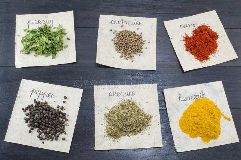 Various spices on recycled papers with labels placed royalty free stock photography