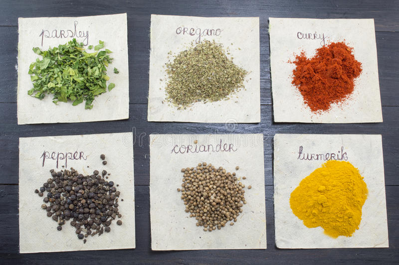 Various spices on recycled papers with labels placed stock images