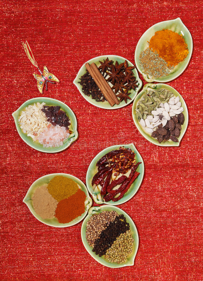 Various Spices In Seven Leaf Shape Plates Glitter Royalty Free Stock Photo