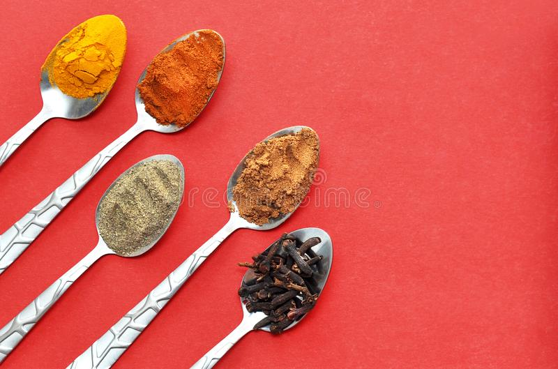 Various spices in spoons royalty free stock photography