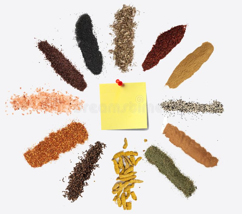 Various spices on white background. Top view with free space, and note. royalty free stock image