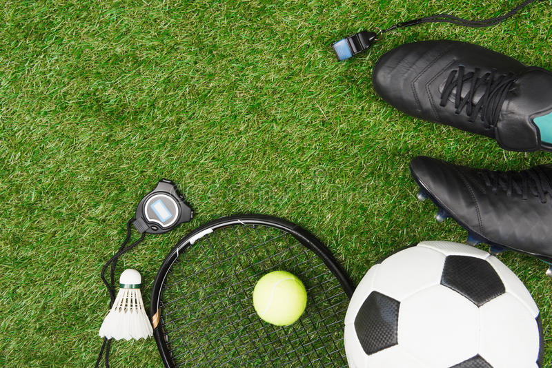 Various sport equipment on green grass royalty free stock photography