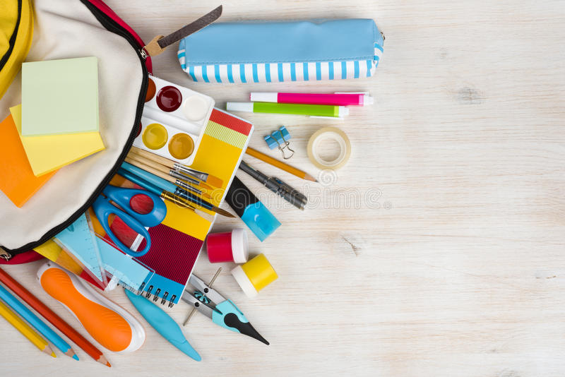 Various stationery school and office supplies over wooden texture background royalty free stock image