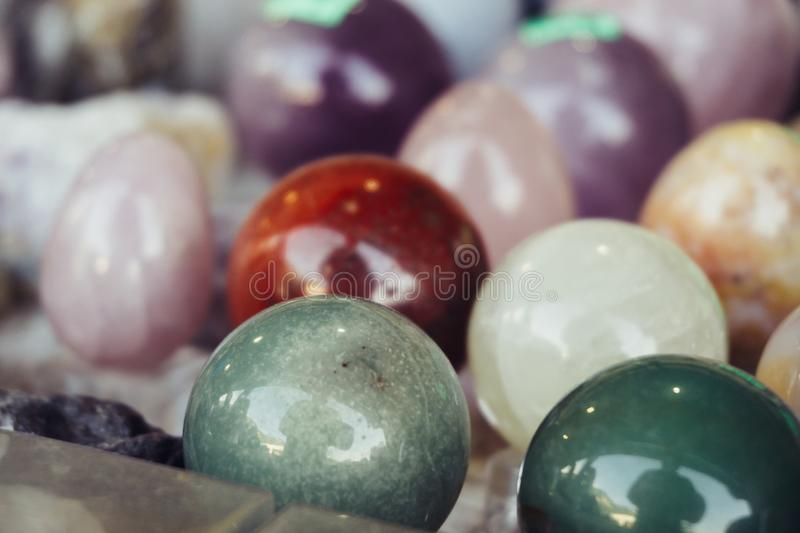 Various stone or rock polished balls, magic esoteric mineral objects or geology textured round samples stock photography