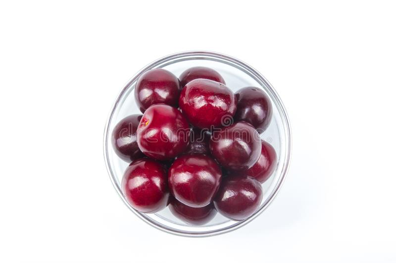Fresh cherry on plate on Isolated white background. fresh ripe cherries. sweet cherries. Berries royalty free stock photo