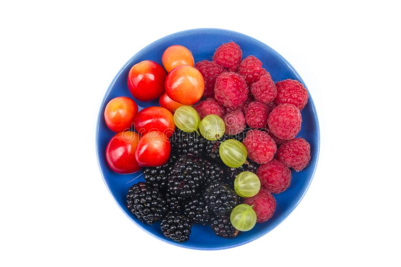 Various summer Fresh berries in a bowl on rustic wooden table. .Antioxidants, detox diet, organic fruits. Top view stock photography