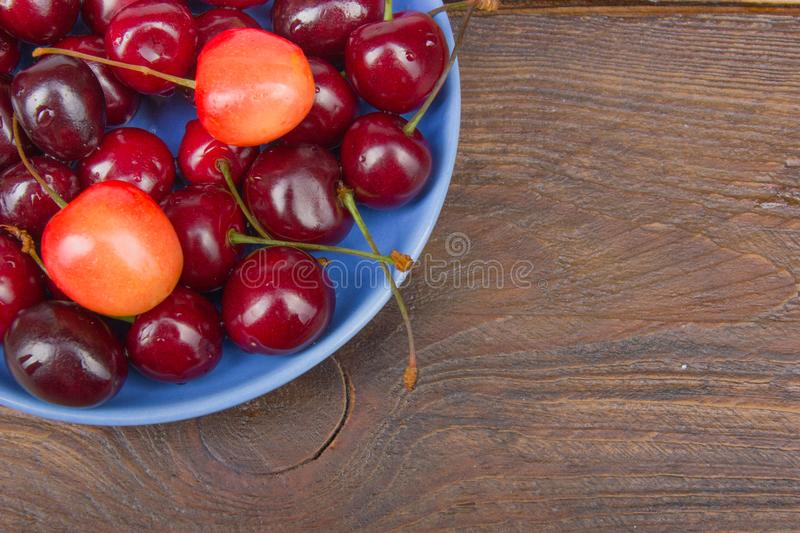 Various summer Fresh Cherry in a bowl on rustic wooden table. Antioxidants, detox diet, organic fruits. Berries royalty free stock photography