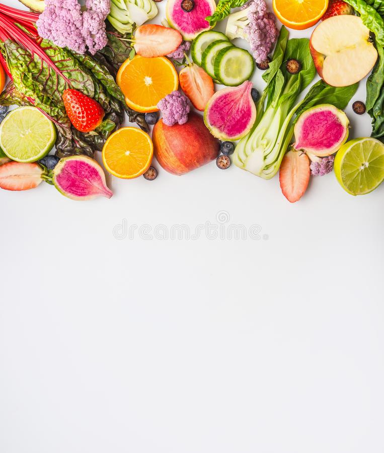 Various summer fruits and vegetables on white background , top view. Food border. Healthy lifestyle stock images