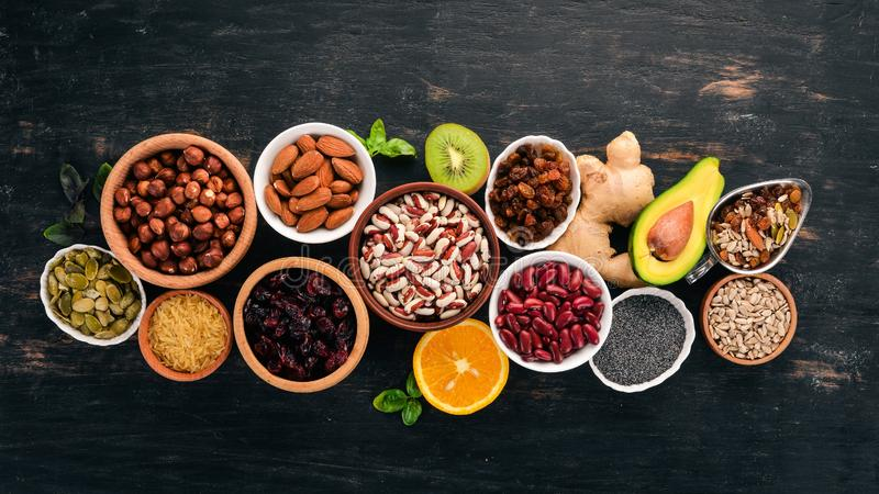 Various Superfoods. Dried Fruits, Nuts, Beans, Fruits And ...