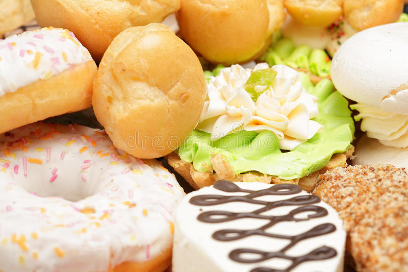 Various sweet cakes royalty free stock photo