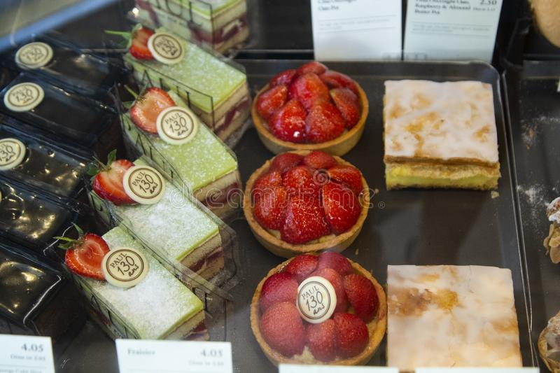 Various sweets and cakes in shop window. Bakery shop in london stock image