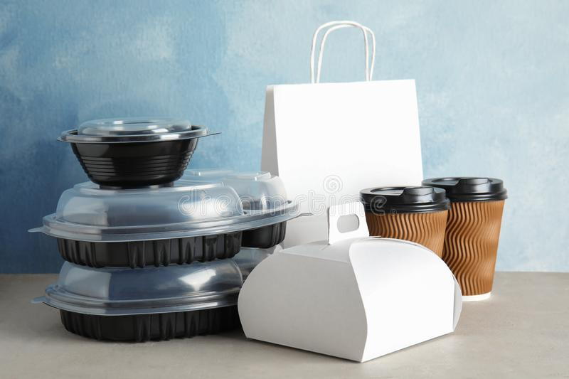 Various takeout containers on table. Food delivery. Service stock image