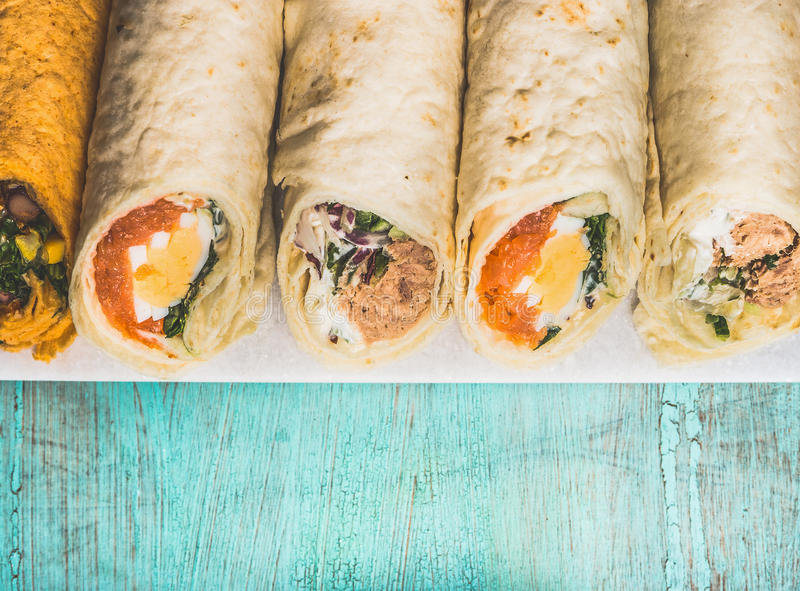 Various of tasty wraps on light wooden background top view border download various of tasty wraps on light wooden background top view border healthy sisterspd