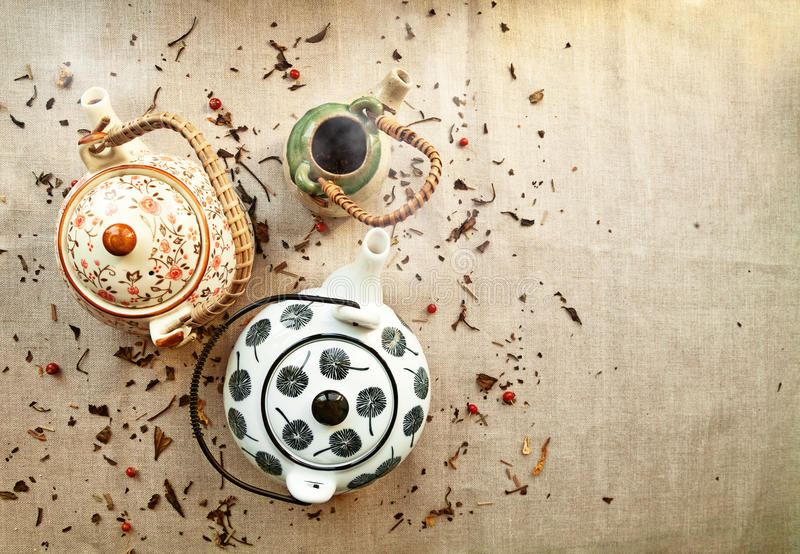 3 various traditional ceramic teapots on a canvas background stock image