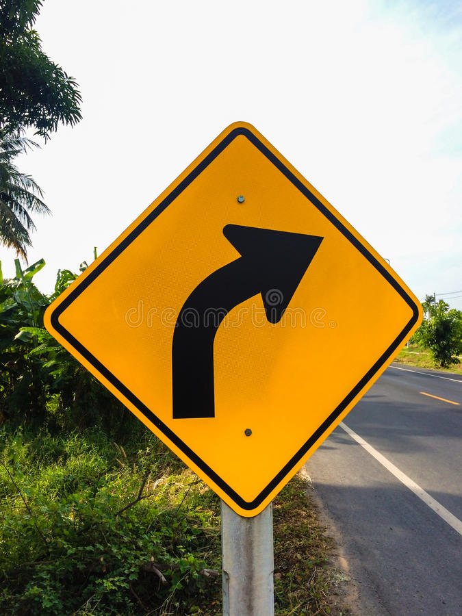 Various traffic signs beside country road. And the blue sky with strong sunlight royalty free stock photo