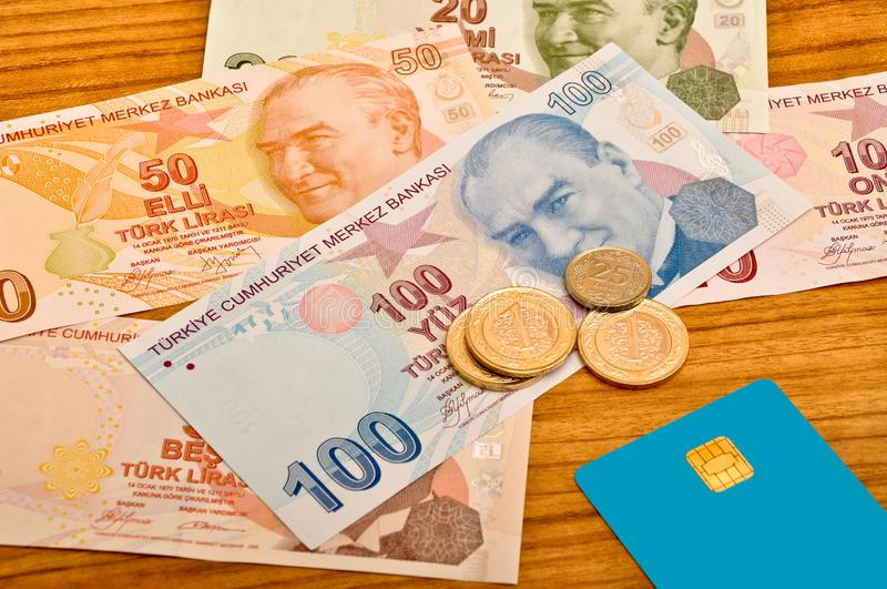 Various Turkish lira banknotes front view. Coin and credit card. Various Turkish Lira banknotes printed by the Central Bank of Turkey, front view. Coin and royalty free stock images