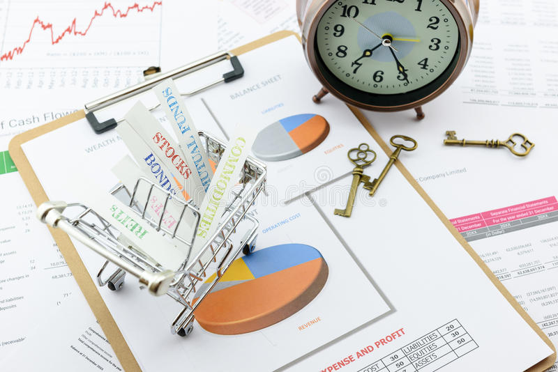 Various type of financial and investment products in a shopping cart. royalty free stock photo