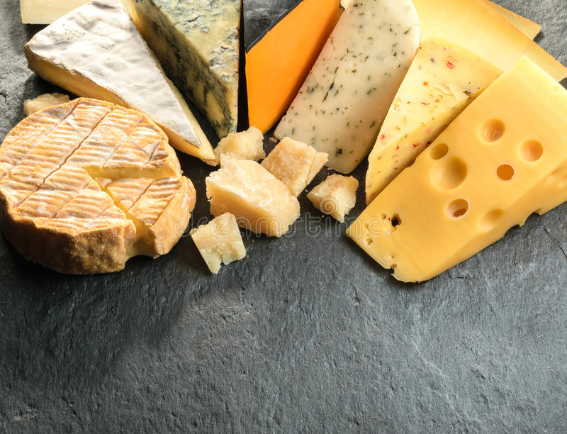 Various types of cheese with empty space background stock photos