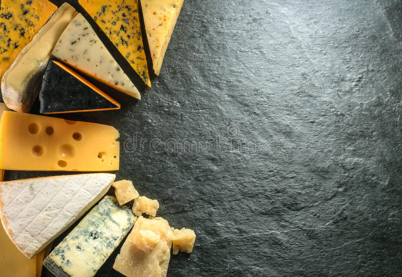 Various types of cheese with empty space background royalty free stock images