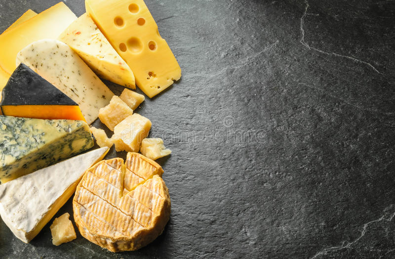 Various types of cheese with empty space background stock image