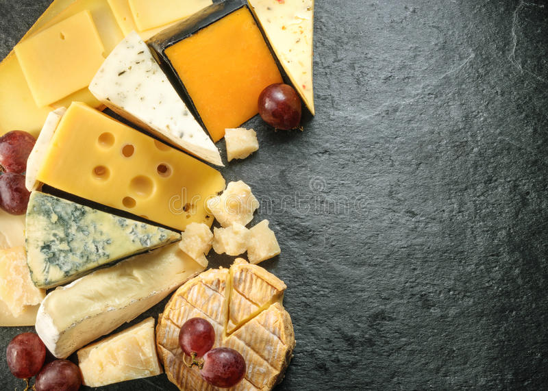 Various types of cheese with empty space background royalty free stock photography