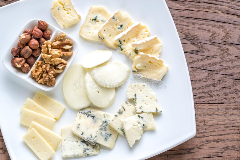 Various types of cheese. Slices of various types of cheese on the plate royalty free stock photography