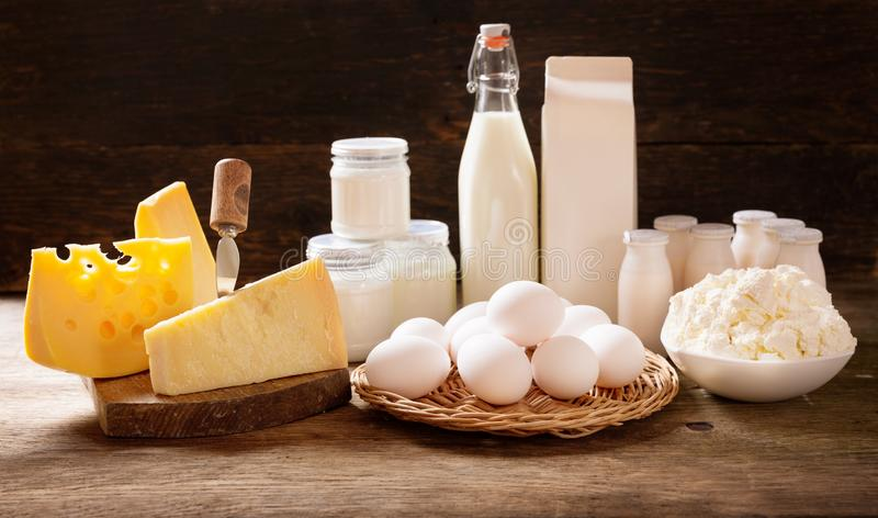 Various types of dairy products on rustic wooden table stock images