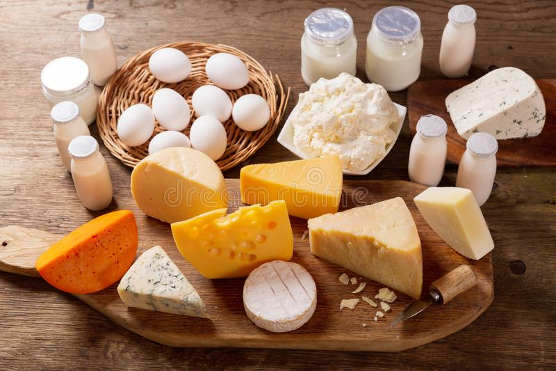 Various types of dairy products on rustic wooden table stock photography