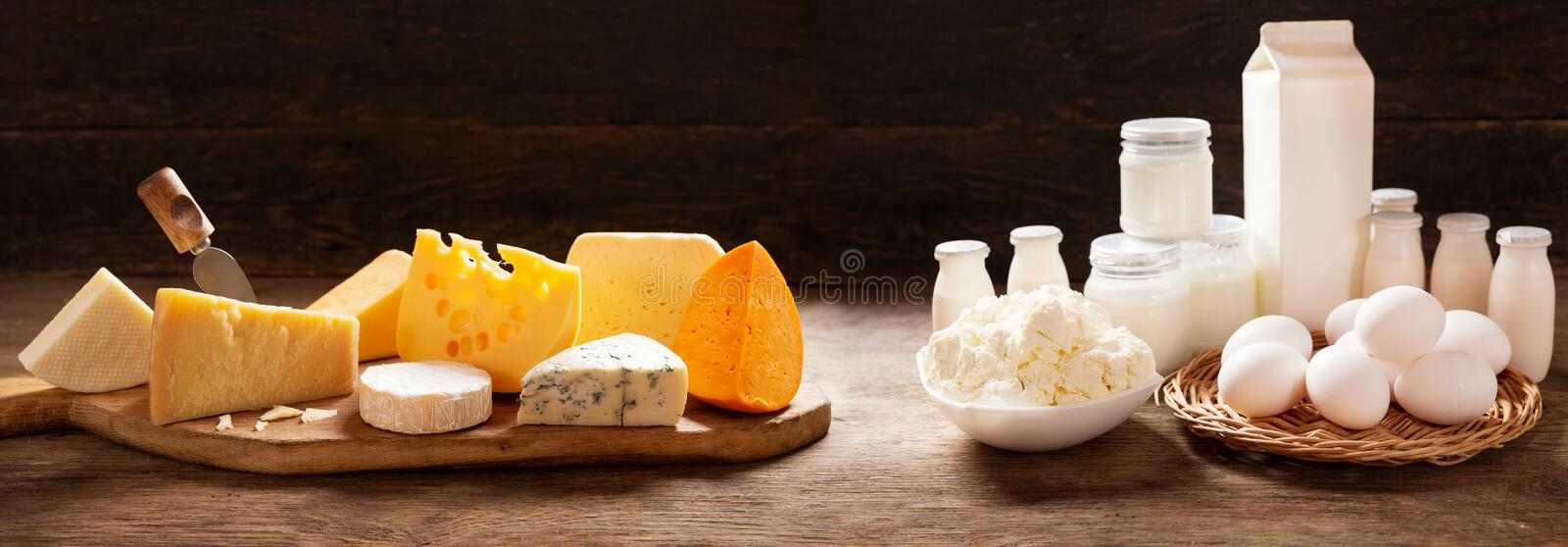 Various types of dairy products on rustic wooden table stock image